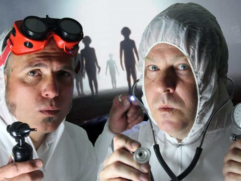A publicity shot for the show with Jon and Martin dressed in biohazard suits.