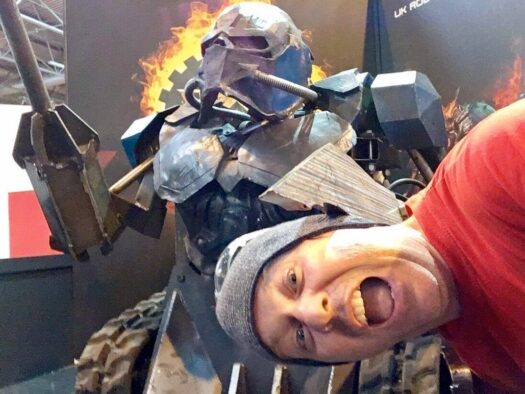 Jon poses for a selfie within the metal claws of Sir Killalot from Robot Wars