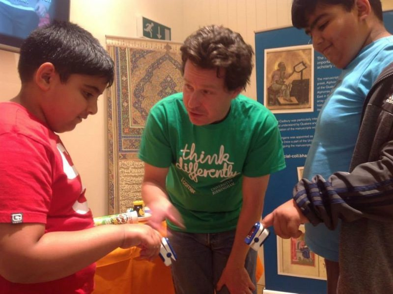 Jon talks with volunteers taking part in an experiment about breathing.