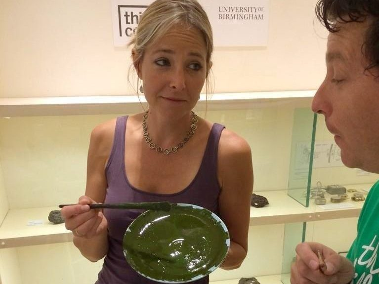 Jon offers a plate of Marmite to broadcaster Alice Roberts who offers him paint in return.